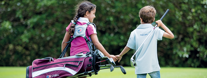 kids carrying golfing gear at ile aux cerfs golf club